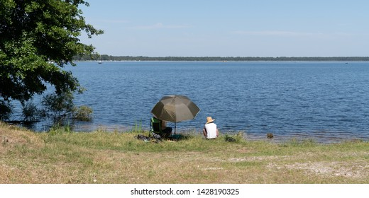 man and woman couple fishing by lake in summer in web banner template