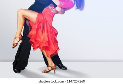 Man and a woman dancing Salsa