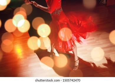 Man and a woman dancing Salsa