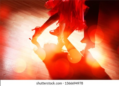 Man and a woman dancing Salsa on
