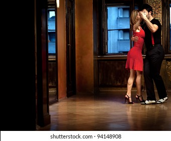 A man and a woman dancing tango. Focus on their hands. Please see more images from the same shoot.