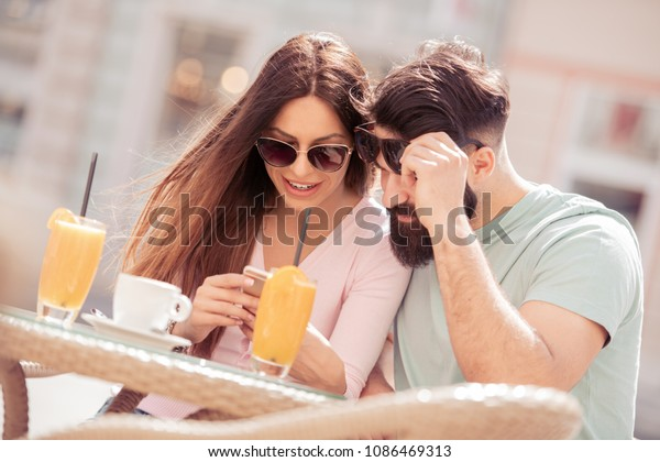 Man and woman dating in cafe.They are enjoying spending time together.