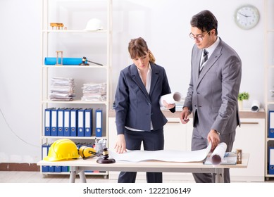 Man and woman discussing construction project