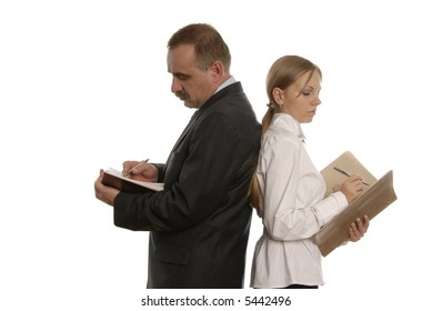 a man and a woman with documents are standing back close to back