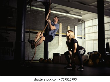 Man and woman doing exercises in gym