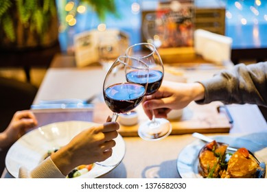 Man and woman drinking red wine in the restaurant
