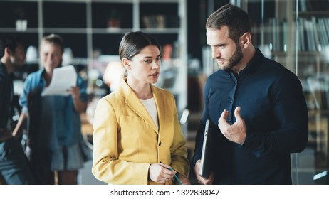 Man and woman employees have meeting in the office. Daily business situations