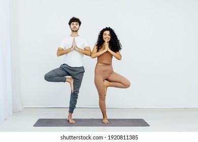 Man and woman engaged in yoga asana sports gymnastics fitness