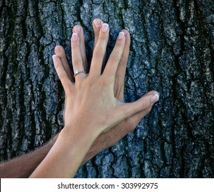 man and woman engagement ring showing off on tree trunk with instagram filter