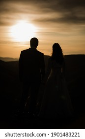 Man and woman enjoy the sunset