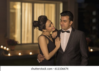Man and woman in evening wear embracing