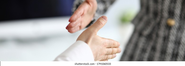 Man and woman extend their hands in greeting. Business process management specialist. Supporting development effective self-presentation skills. Perform all tasks at home during quarantine