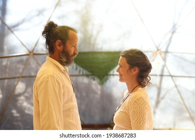 Man and woman facing each other in a medium shot in a couple's practice.