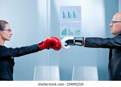 man and woman facing each other with box gloves ready to fight loyally