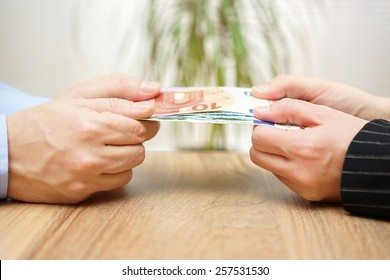 man and woman are fighting over money