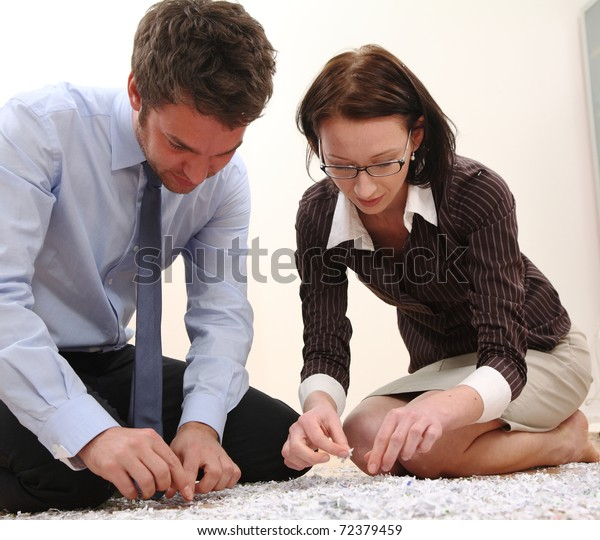 Man and Woman with file shredder
