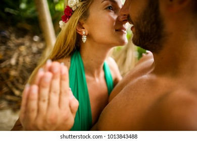man and woman  with flower crown in nature