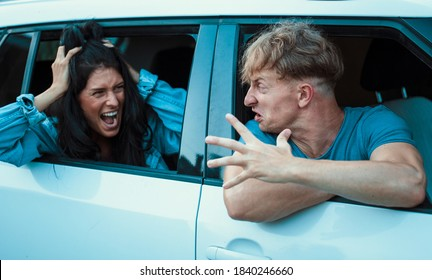 Man and woman funny couple arguing in car having relationship problem. Anrgy couple. People. Family problem.