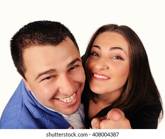 Man and woman with funny faces isolated over white background