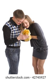 Man and woman giving the gifts to each other