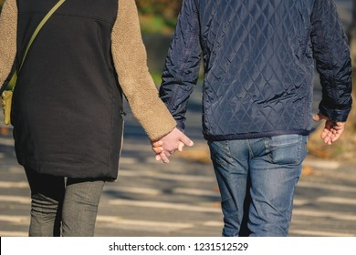 Man and woman go for a walk and hold their hands in germany cologne 2018.