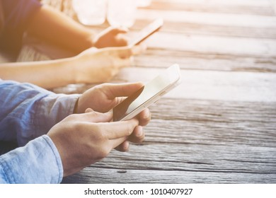 Man and woman hand holding smartphone in restaurant, Food and drink concept, She using application on mobile phone.selective focus