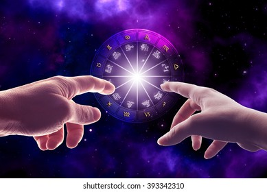 man and woman hands touching an astrology chart with all zodiac signs