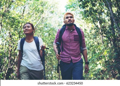 Man and woman happy with trekking.