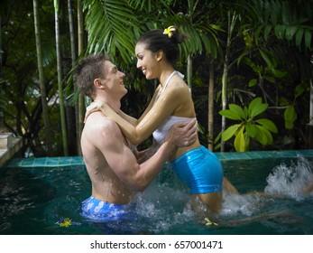 Man and woman having fun in the pool