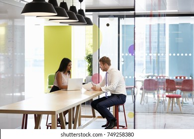 Man and woman having an informal meeting at work