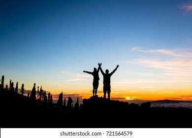 Man and woman hikers looking at inspirational landscape on Tenerife Canary Islands, Spain.