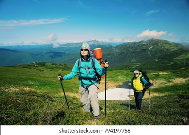 Man  and woman hiking in mountains with backpack Travel sport lifestyle concept active weekend summer vacations wild trek.