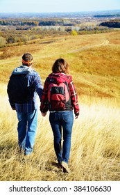 Man and woman are hiking together