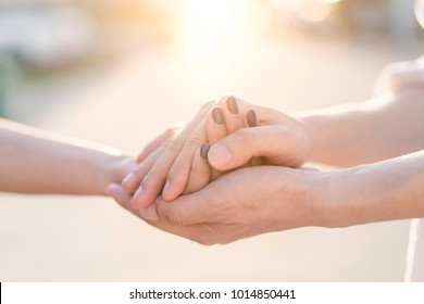 Man and woman holding hands to take care and help each other.