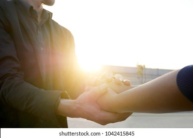 Man and woman holding hands to take care and help each other.Help and sharing ideas