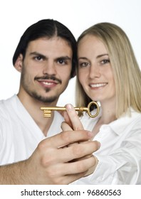 Man and woman holding key