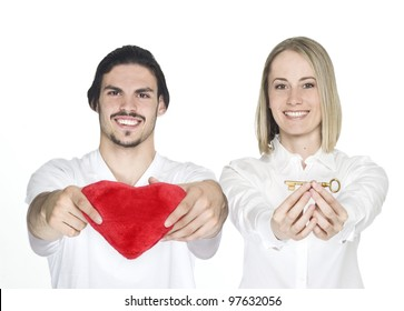 Man and woman holding key and heart