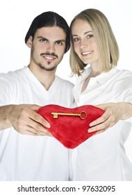 Man and woman holding key with heart