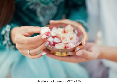 man and woman holding vintage bowl with turkish delight