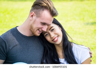 Man and woman hugging each other in the park for Couple of love or valentine day concept