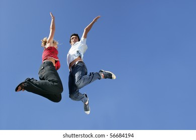 Man and woman jumping in the air
