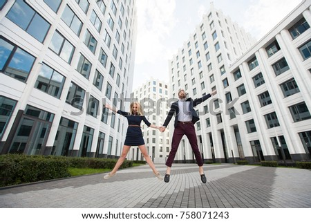 man woman jumping on background building stock photo edit now