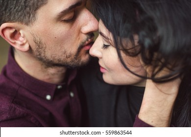 Man and woman  kissing  in bed. Close-up.