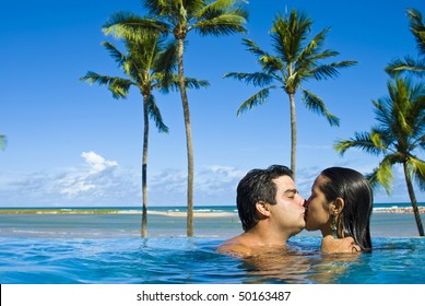 Man and Woman kissing in the pool .