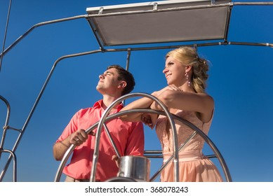 Man and woman lead yacht