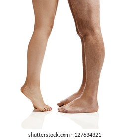 Man and woman legs isolated on a white background
