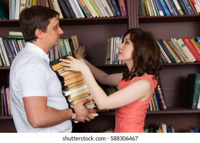 man and woman in the library