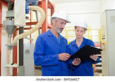 Man and woman looking at clipboard