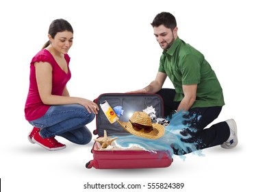 Man and woman are looking in suitcase