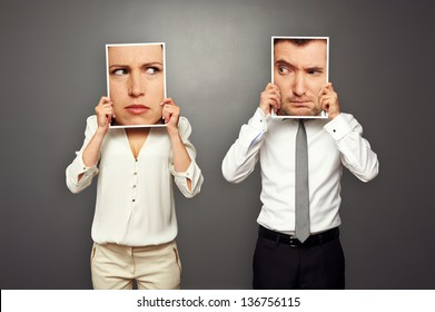 man and woman looking suspiciously at each other. concept photo